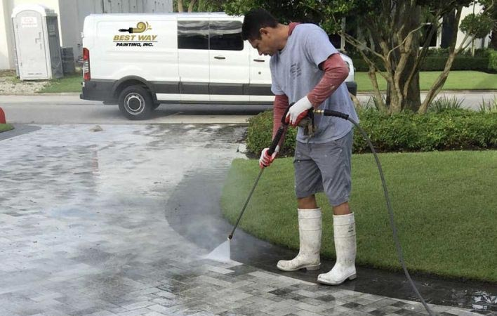 Best Way Painting performing pressure washing service at Naples, Florida home | Best Way Painting, Inc.